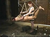 Women torment and assfuck their slave