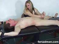 Young dominatrix doing CFNM handjob