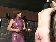 She mount clashing a slaveboy at the end of one's tether caning him commonly