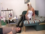 The fetish domme Sade allows her slaveboy to jerk on her boot