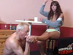 Strict domme gave slave spanking after he kissed her feet