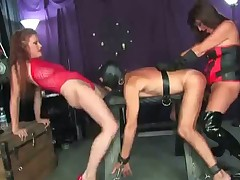 Two merciless mistresses torture their poor slave hard