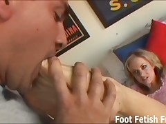 Mistress in high heels likes to give footjob to her slave