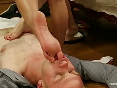 Sexy young mistresses practice footdom with slave
