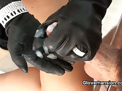 Mistress in black gloves stroking subby's cock