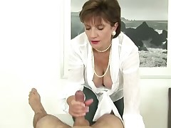 Mature domme likes to tug her subby's dick