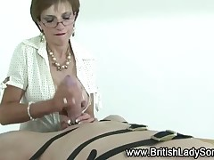 Mature domme jerked slave off till cum