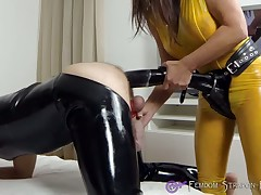 Burnish apply latex dominatrix pegged a malesub hard by famous hanker funereal strapon didlo.