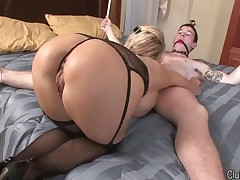Perverted mistress tortures her slave with hot wax