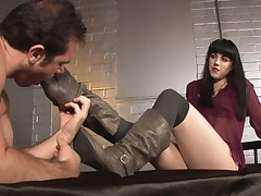 Dominatrix and weak boy that licking her shoes