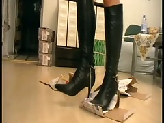 Domme in red boots humiliated her sub