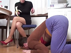 Dominatrix is torturing sub with trampling his hands