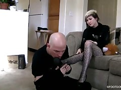 Sexy brunet bitch in black stockings with her foot slave