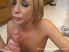 Adorable skinny babe gives expert handjob to big cock