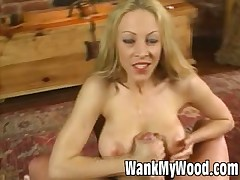 Naughty babe rubbing cock till it explodes with sperm
