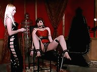 Cute submissive Madison Young is wearing a red corset and gets bound with chains