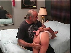 Slinky blonde milf gets a hard spanking from old guy