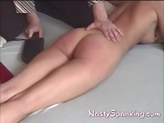 paddle and hand spanking ass