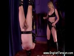 Prodomme spanks him while in suspension