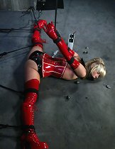 Flexible blonde is tied up, vibrated, and electrified