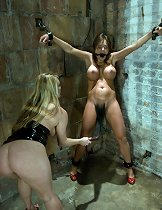 Busty beauty in bondage and sexually dominated by lesbian.