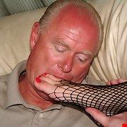 Girl in fishnets footjobs foot fetishist's dick