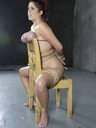 Busty babe bound on the chear