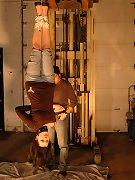Pretty slavegirl tied and suspended