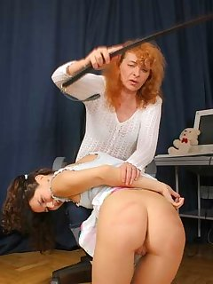 <!–-IMAGE_COUNT-–> of Hot brunette spanks blonde ass hard