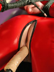 Rose in red latex bound, gagged and dildo abused