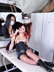 Mistress Jemstone stretches Kaylas wet pussy with a speculum