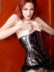 Sexy redhead wore latex corset