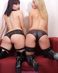 These gorgeous lesbians love to play with leather boots on