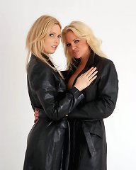 Fran and Lou are dressed in gorgeous leather trench coats and not a lot else.