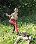 Riding mistress dominating outdoors