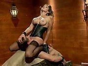 Hot dark leather clad headmistress has dominating sex with muscular slaveboy.