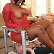 Big mistress in red sat on slave
