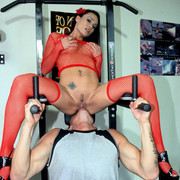 Sexy Rose riding muscle man's face in a gym