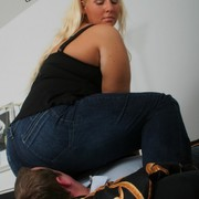 Big round ass in jeans on slave's face