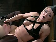 Lucky slave is completely used as a tool for sex and pleasure by two dommes and has his cum milked from his loins while receiving strap-on sex!