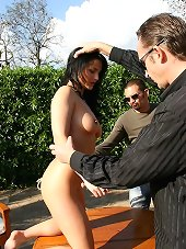Master bullwhips a brunette slut on the table