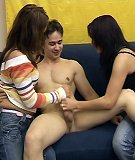 Two girls stroke dick