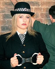 Uniformed Mistress Birch takes care of the insubordinate worm