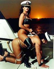 Mistresses sit on pony male slaves