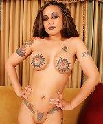 Tattooed babe strips off spooky dress gets nude