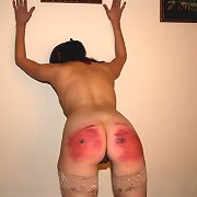 Mature strapped and caned