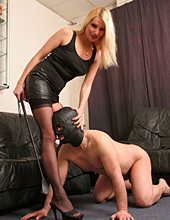 Lady Natalie makes her slave worship her shoes before forcing his face into her arse