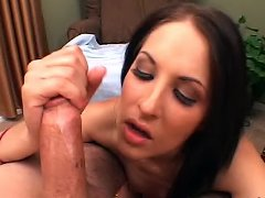 Hot brunette chick rubs on a towering cock with her smooth hands