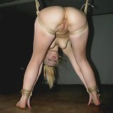 Blonde slavegirl suspended, bound and hard fucked