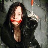 Girl in black latex bound